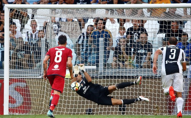 Juventus' Gianluigi Buffon saves a penalty taken by Cagliari's Diego Farias.