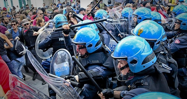 Italian riot police deploy tear gas at anti-G7 protest