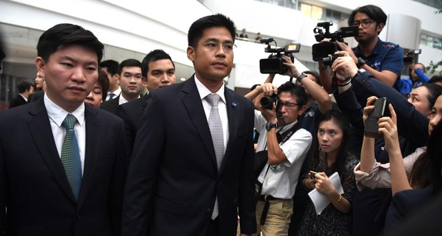 Thai Raksa Chart party leader Preechaphol Pongpanich C with other officials leaves the Constitutional Court in Bangkok on March 7, 2019, after a court ruling. AFP Photo