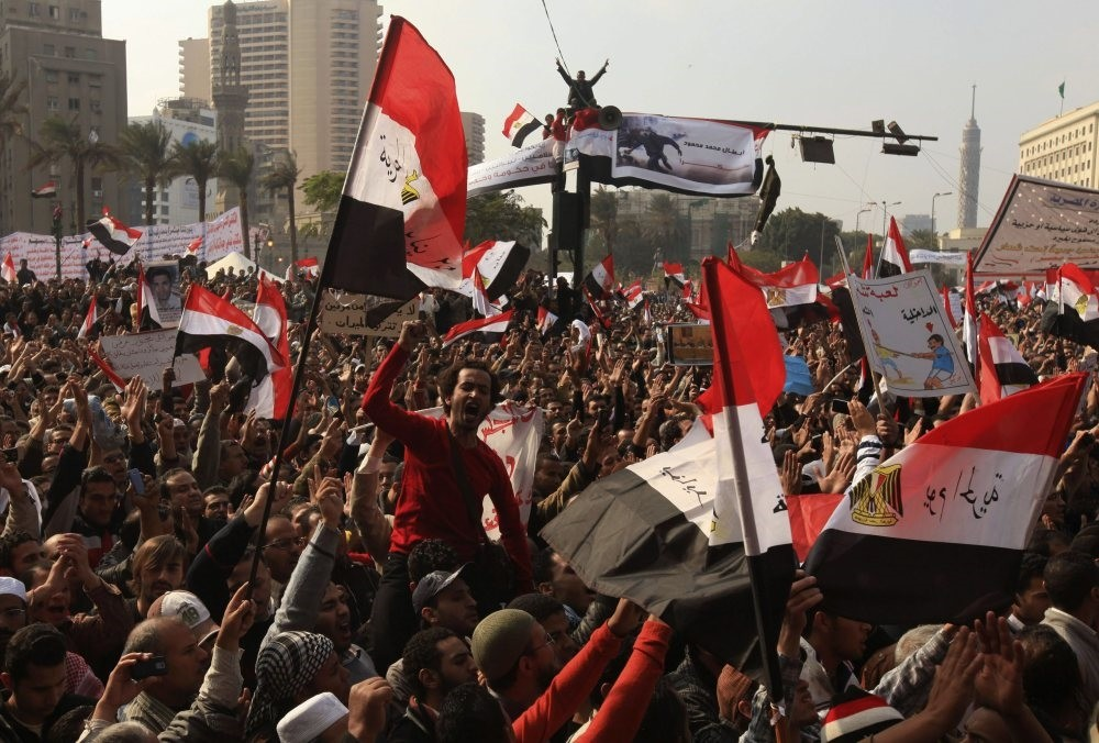 Protesters chant slogans against the Egyptian military council during a demonstration in Tahrir square, Cairo, Nov. 25, 2011.