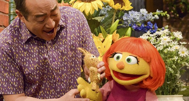 This image released by Sesame Workshop shows Julia, a new autistic muppet character debuting on the 47th Season of Sesame Street, on April 10, 2017. (AP Photo)