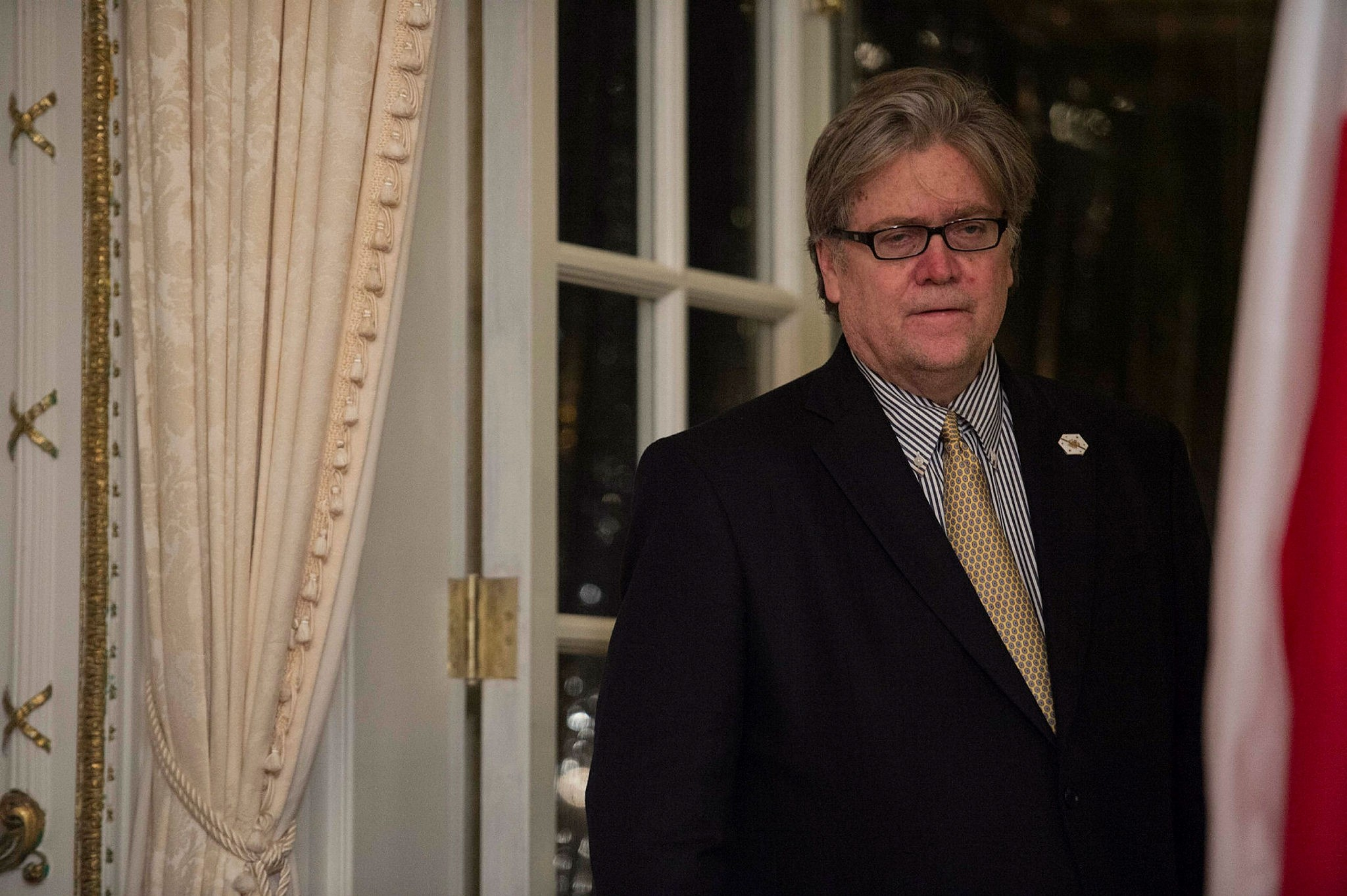This February 11, 2017 file photo shows Steve Bannon, then US President Donald Trump's chief strategist, standing aside at Trump's Mar-a-Lago resort in Palm Beach, Florida (AFP Photo)