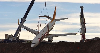 pTurkish authorities completed lifting of a passenger plane that skidded off a runway in northern Turkey's Tranzon and stopped on the side of a slope meters away from the Black Sea./p