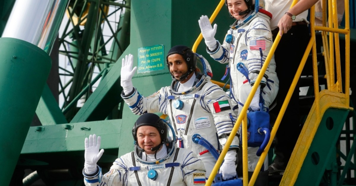 United Arab Emirates astronaut Hazza Al Mansouri, centre, Russian cosmonaut Oleg Skripochka, bottom, and U.S. astronaut Jessica Meir, top, members of the main crew to the International Space Station (ISS) (AP Photo)