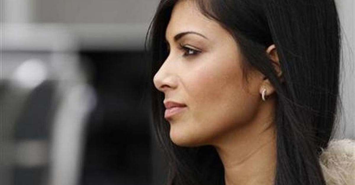 Nicole Scherzinger, girlfriend of McLaren Formula One driver Lewis Hamilton of Britain, is seen in the pits before the qualifying session of the Australian F1 Grand Prix at the Albert Park circuit in Melbourne March 26, 2011 (Reuters File Photo)