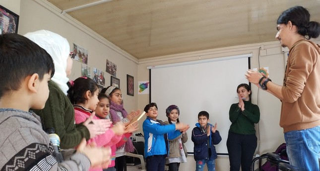 University students offer classes, games for young refugees