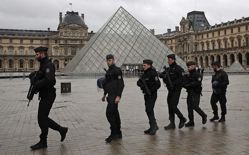 Armed police officers patrol in the courtyard of the Louvre museum near where a soldier opened fire after he was attacked in Paris, Friday, Feb. 3, 2017 (AP Photo)