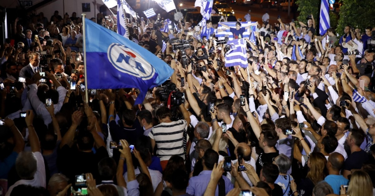 New Democracy (ND) conservative party leader Kyriakos Mitsotakis (L) addresses to his supporters after his victory in the parliamentary elections, at the ND headquarters, Athens, July 7, 2019.