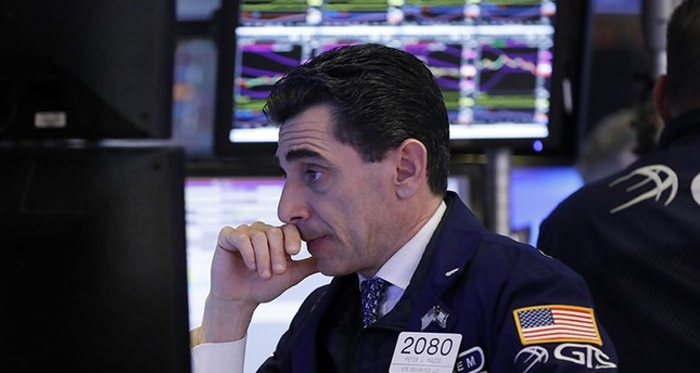 Specialist Peter Mazza works at his post on the floor of the New York Stock Exchange, Thursday, Dec. 6, 2018. (AP Photo)