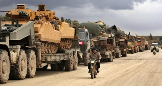 Turkish military convoy drives through the village of Binnish, in Idlib province, Syria, Saturday, Feb. 8, 2020. AP Photo