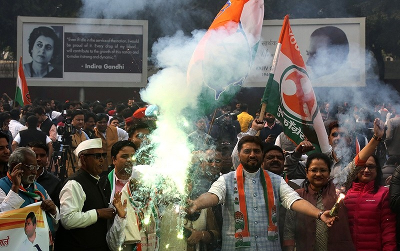 Congress party workers celebrate the party's lead in votes counting and potential victory in recently held Assembly elections, at party headquarter in New Delhi, India, Dec. 11, 2018. (EPA Photo)