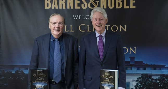 In this June 5, 2018 file photo, former President Bill Clinton, right, and author James Patterson pose for photographers during an event to promote their new novel, The President is Missing, in New York. (AP Photo)
