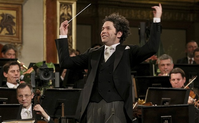 In this Jan. 1, 2017 file photo, maestro Gustavo Dudamel of Venezuela conducts the Vienna Philharmonic Orchestra during the traditional New Year's Concert at the Golden Hall of the Musikverein in Vienna, Austria. (AP Photo)