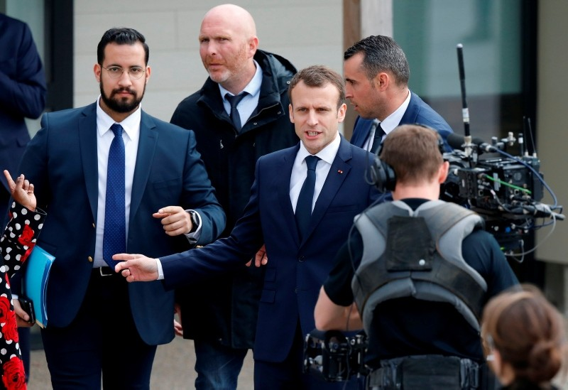 In this file photo taken on April 12, 2018 President Macron (C), next to Elysee Chief Security Officer Alexandre Benalla (L), arrives at a primary school in Berd'huis, northwestern France, for a television interview. (AFP Photo)