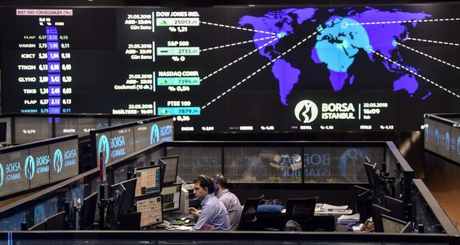 Traders working at their desks in the open office of the Borsa İstanbul, May 22.