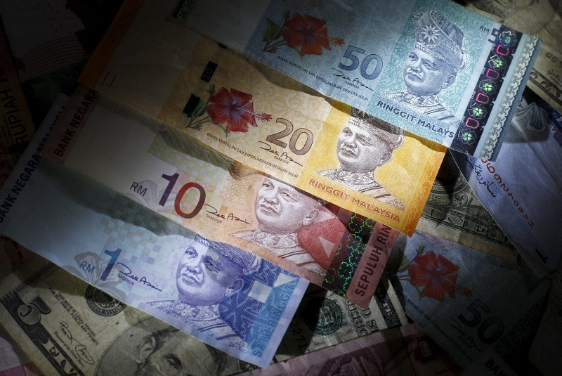 Malaysian ringgit notes are seen among other currency notes in this photo illustration taken in Singapore, in this March 14, 2013 file photo. (REUTERS Photo)