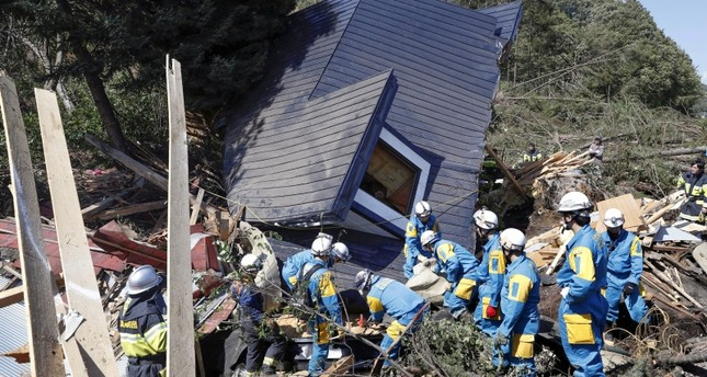 Rescue workers search for survivors from a house damaged by a landslide caused by an earthquake in Atsuma town, Hokkaido, Japan, September 6, 2018. (Kyodo via Reuters Photo)