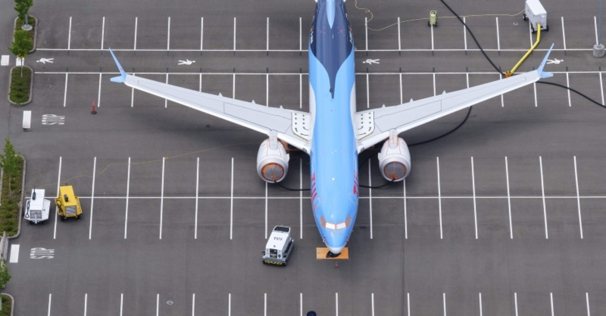 In this file photo taken on June 27, 2019, a Boeing 737 MAX airplane is stored on an employee parking lot adjacent to Boeing Field in Seattle, Washington. (AFP Photo)