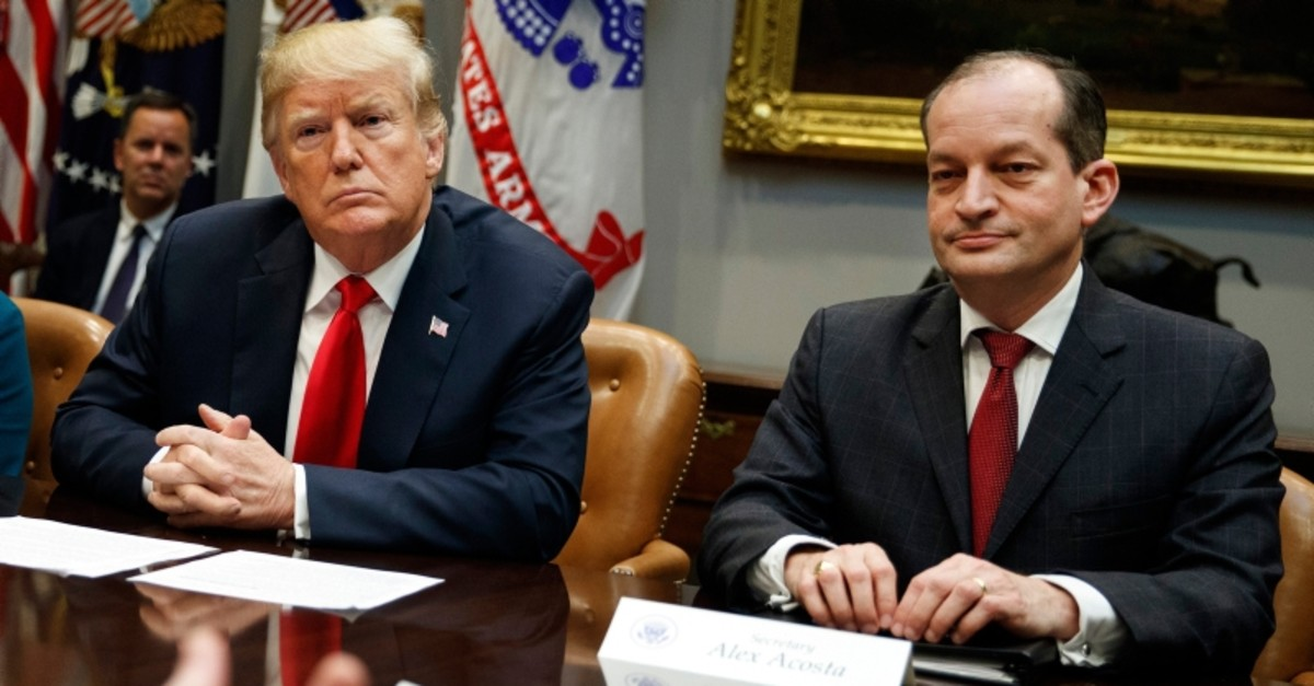 In this Sept. 17, 2018, file photo, Pres. Donald Trump, left, and Labor Secretary Alexander Acosta listen during a meeting of the President's National Council of the American Worker in the Roosevelt Room of the White House in Washington. (AP Photo)