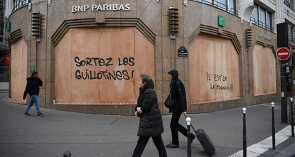 'Yellow vest' protests stunt French growth, Macron under pressure