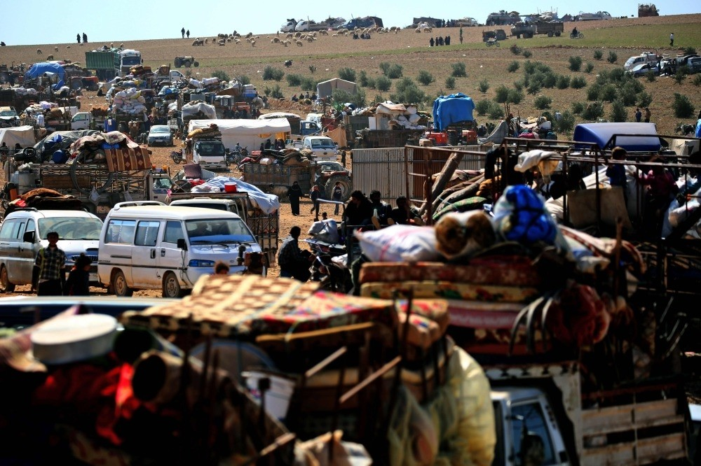 Displaced Syrians gathering at a makeshift camp for displaced people near the northern town of Manbij, March 8.