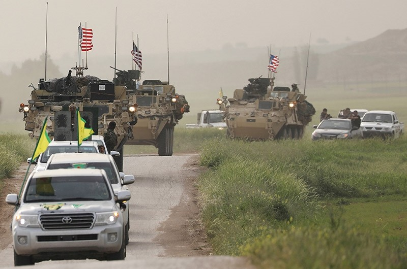 Kurdish fighters from the People's Protection Units (YPG) head a convoy of U.S military vehicles in the town of Darbasiya next to the Turkish border, Syria April 28, 2017. (Reuters Photo)