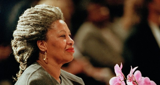 In this April 5, 1994 file photo, Toni Morrison as she holds an orchid at the Cathedral of St. John the Divine in New York. (AP photo)