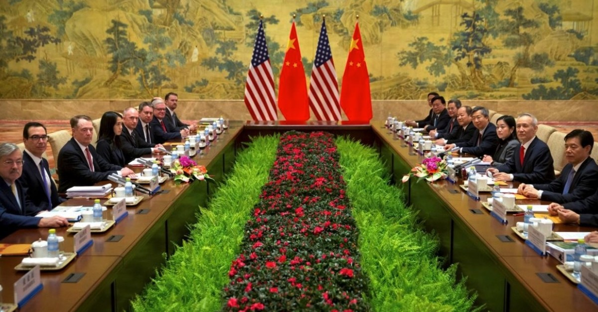 Mnuchin, 2nd from left, U.S. Trade Rep. Robert Lighthizer, 3rd from left, and Chinese VP and lead trade negotiator Liu He, 2nd from right, pose for a photo before the opening session of trade negotiations at the Diaoyutai State Guesthouse in Beijing