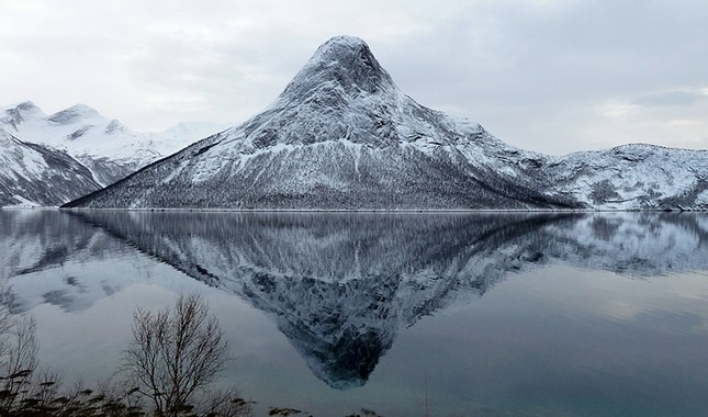 Mount Mulbukt mirrors itself in Tømmeråsfjorden fhord in Tysfjord, Norway. (File Photo)