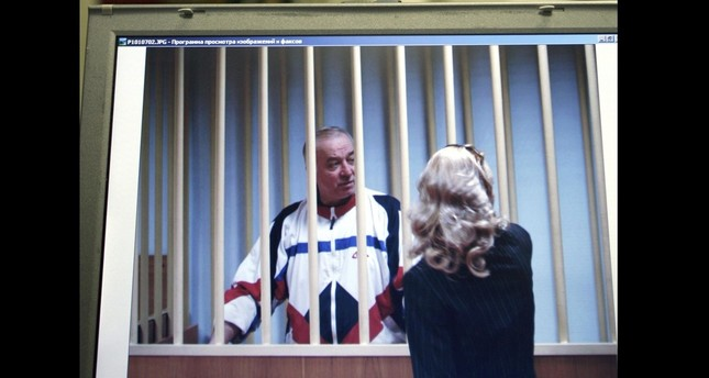 In this Wednesday, Aug. 9, 2006 file photo, Sergei Skripal speaks to his lawyer from behind bars seen on a screen of a monitor outside a courtroom in Moscow. (AP Photo)