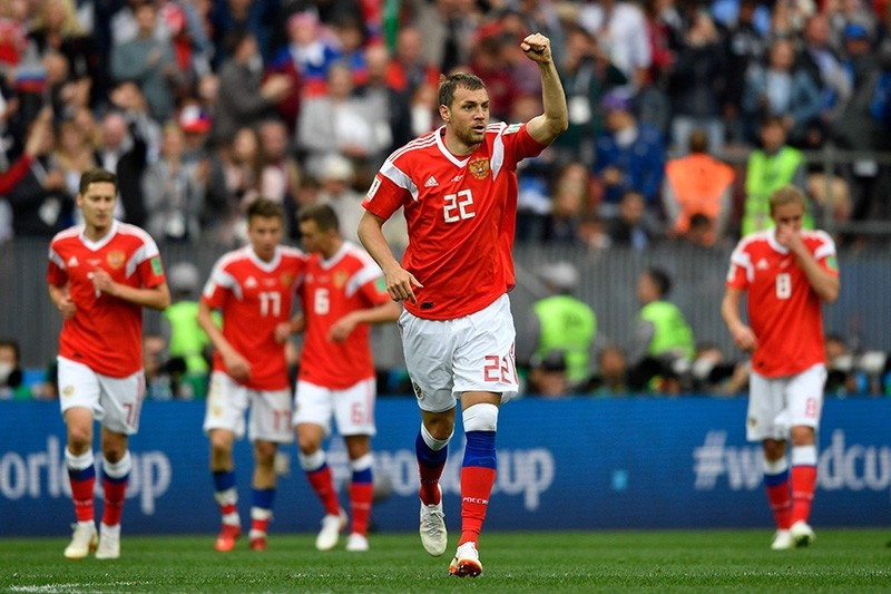 Russia's midfielder Denis Cheryshev (C) celebrates scoring the 2-0 goal with his team-mates during the Russia 2018 World Cup Group A football match between Russia and Saudi Arabia at the Luzhniki Stadium in Moscow on June 14, 2018. (AFP Photo)