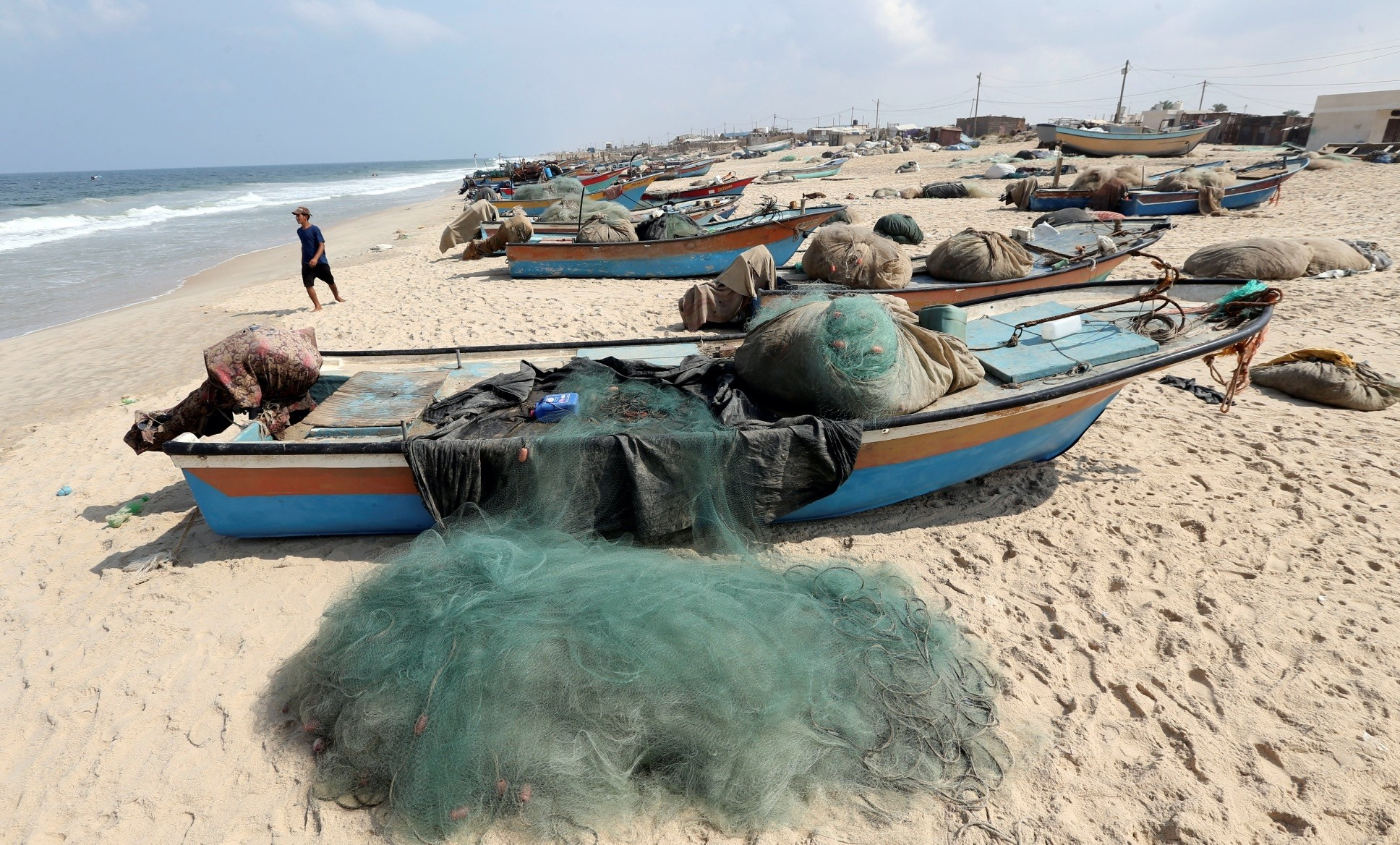 Fishing boats are placed on a beach in the southern Gaza Strip, Oct. 7.