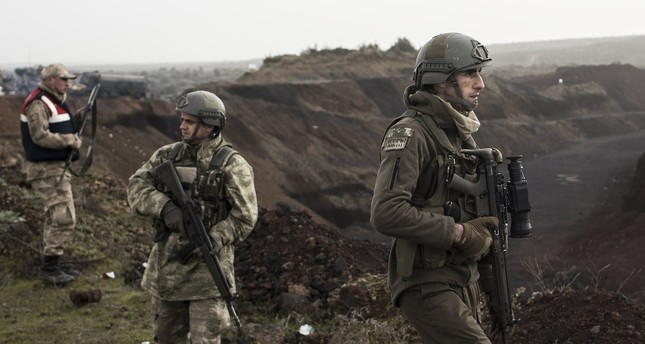 Turkish soldiers wait before crossing the Turkish-Syrian border to join the Afrin operation against YPG terrorists, Hassa, Hatay, Jan. 22.