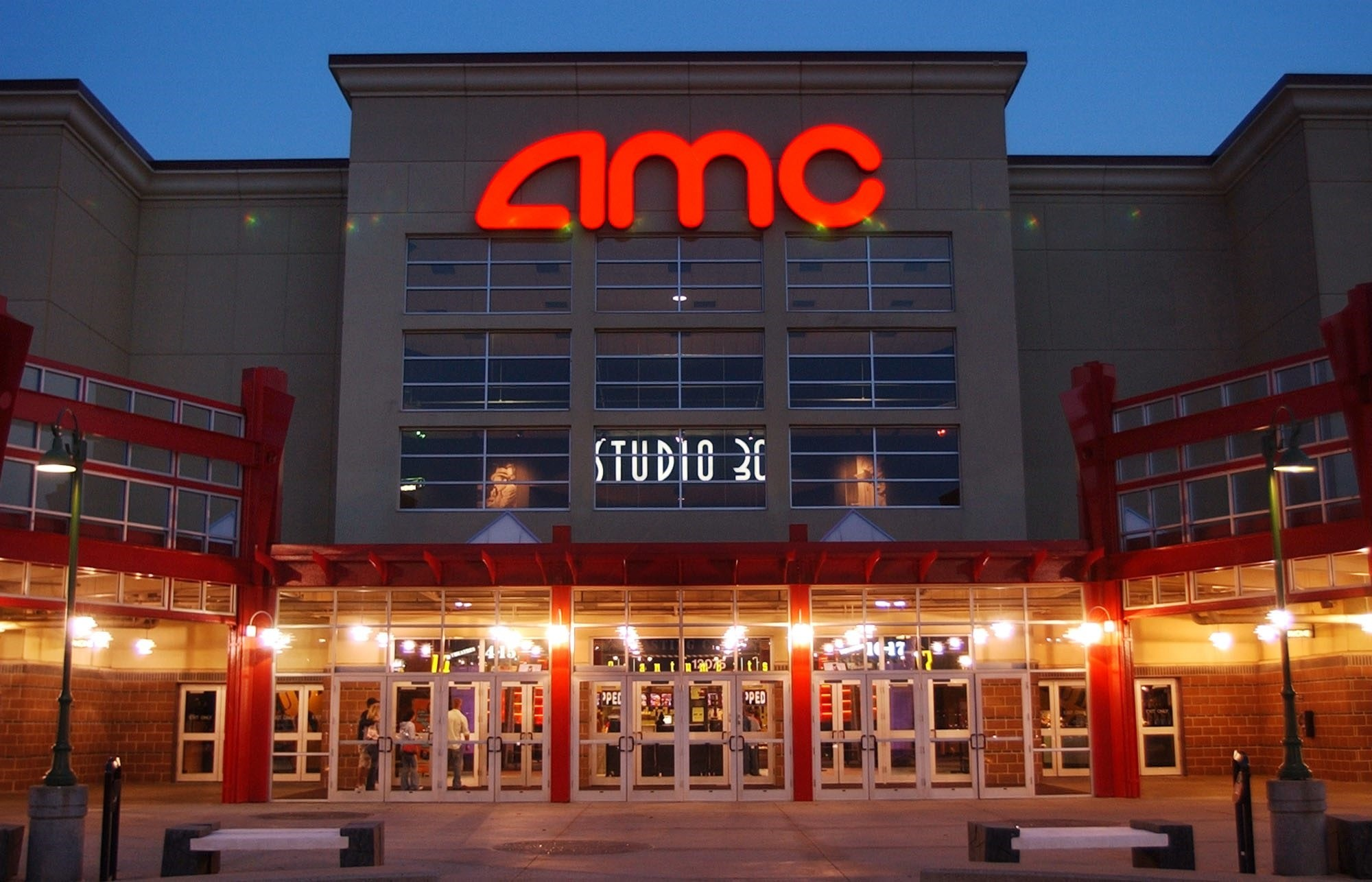 In this May 11, 2005 file photo, people enter AMC's Studio 30 theater in Olathe, Kan. (AP Photo)