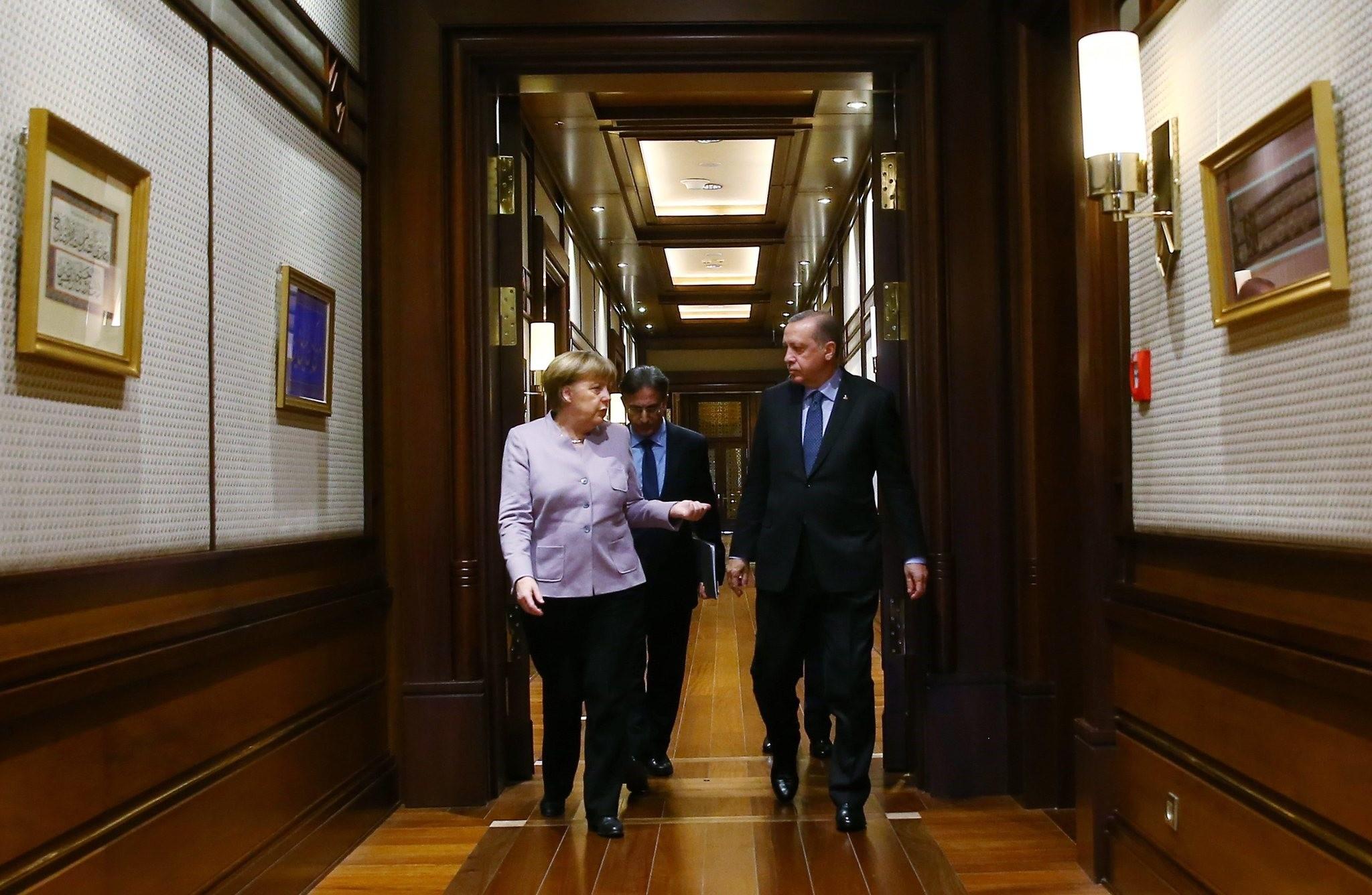 President Recep Tayyip Erdou011fan and German Chancellor Angela Merkel arrive for a press statement after a meeting in Ankara, Feb. 2.