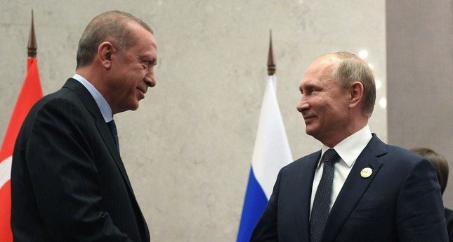Russian President Vladimir Putin (R) meets with his Turkish counterpart Recep Tayyip Erdoğan on the sidelines of the 10th Brics Summit on July 26, 2018 in Johannesburg, South Africa. (AFP Photo)