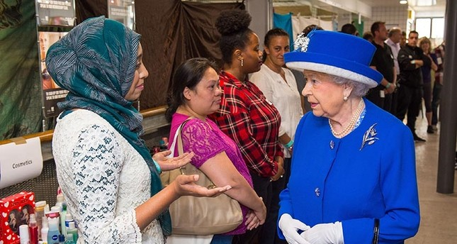 Britain's Queen Elizabeth II meets members of the community affected by the Grenfell Tower disaster during a visit to the Westway Sports Centre (AFP Photo)