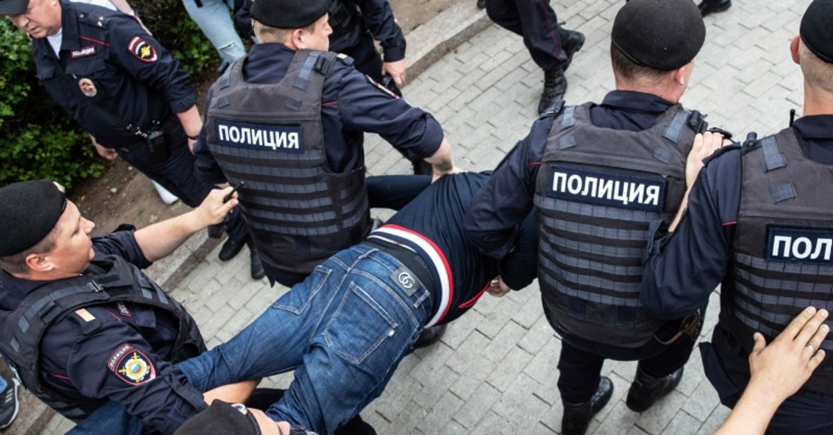 Police officers detain a protester during a march in Moscow, Russia, Wednesday, June 12, 2019. (AP Photo)