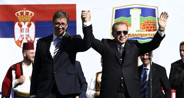 President Recep Tayyip Erdoğan (R) stands with Serbian counterpart Aleksandar Vucic as they visit predominantly Muslim southwestern region of Novi Pazar, Serbia, Oct. 11, 2017. (AA Photo)