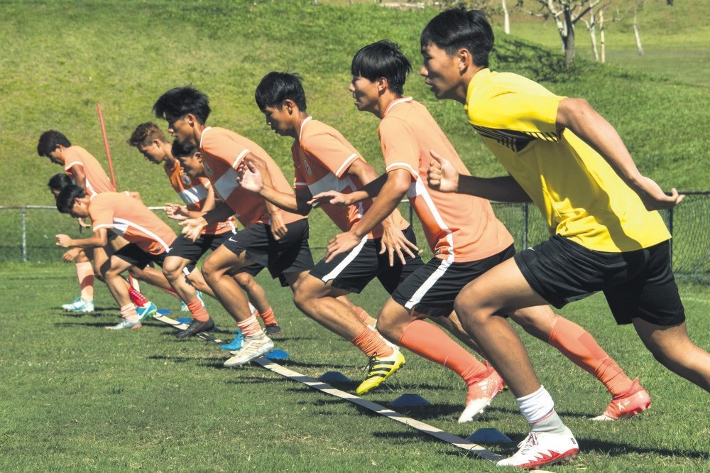Young Chinese players sent by China's Shandong Luneng football club attend a training session at the Luneng Brazil Sports Center located in Porto Feliz, some 120 kilometers from Sao Paulo.