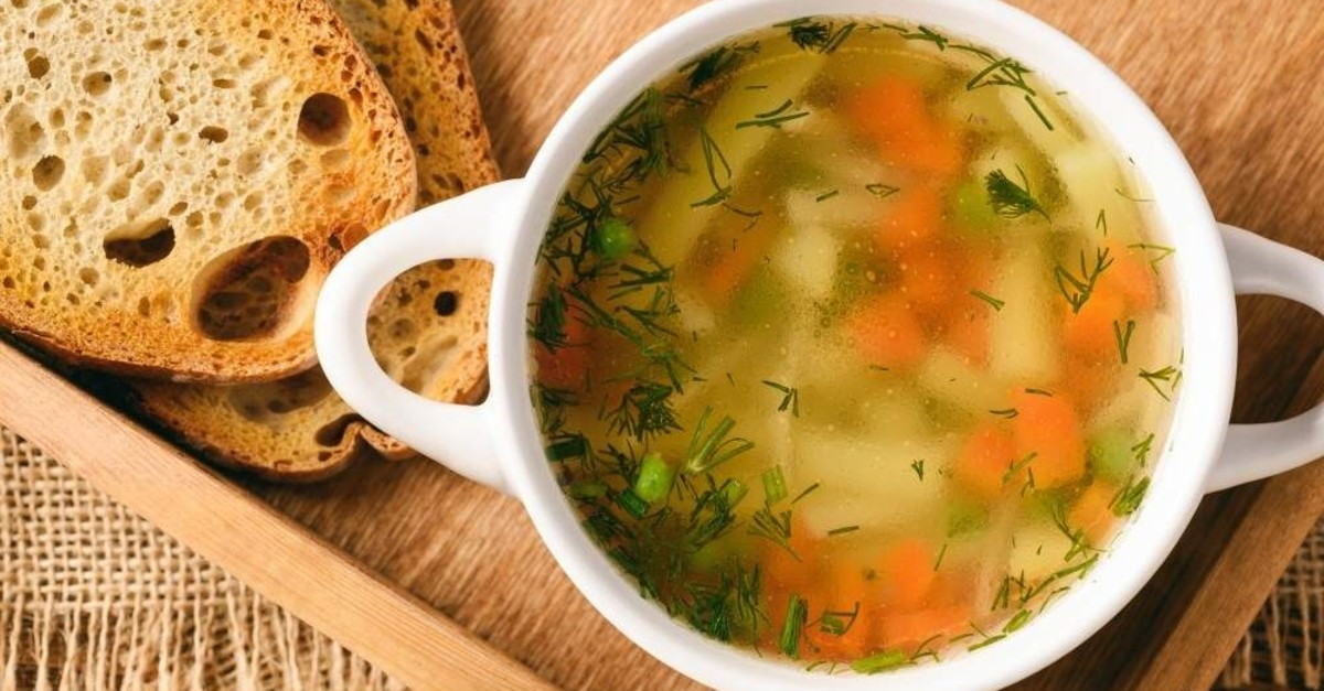 Chicken soup in a white bowl on a wooden tray. (iStock Photo)