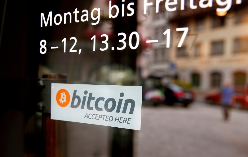 A sticker that reads ,Bitcoin accepted here, is displayed at the entrance of the Stadthaus town hall in Zug, Switzerland, August 30, 2016. (Reuters Photo)