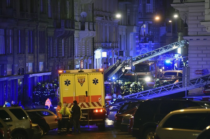 Firefighters and rescuers work at the scene of a hotel fire in downtown Prague on Saturday, Jan. 20, 2018. (AP Photo)