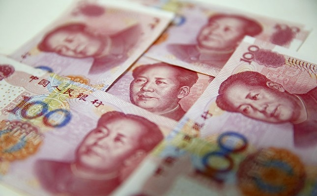 A file picture dated Aug. 12, 2015 shows Chinese yuan banknotes in Beijing, China. EPA Photo