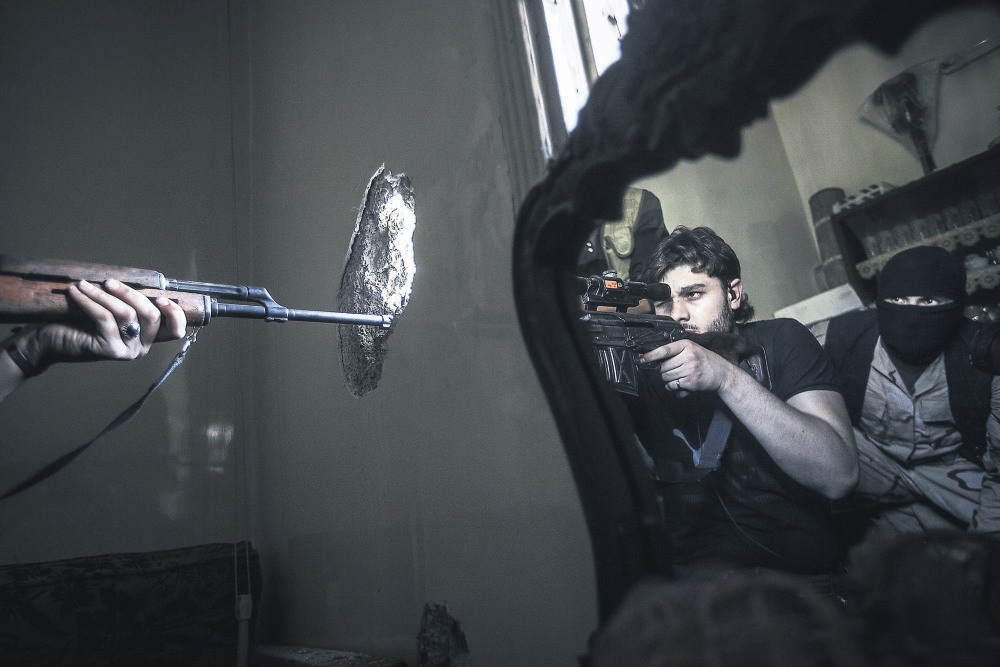 This photo of a rebel sniper taking aim, reflected on a mirror in Aleppo, Syria, won Contreras the Pulitzer Prize in 2013.