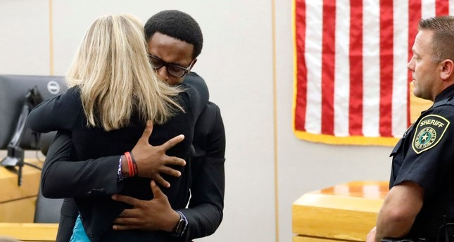 Botham Jean's younger brother Brandt hugs convicted murderer and former Police Officer Amber Guyger after delivering his impact statement to her after she was sentenced to 10 years in jail, Oct. 2, in Dallas. (Tom Fox/The Dallas Morning News via AP)