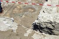 Ancient mosaic depicts Poseidon hailing bath-goers