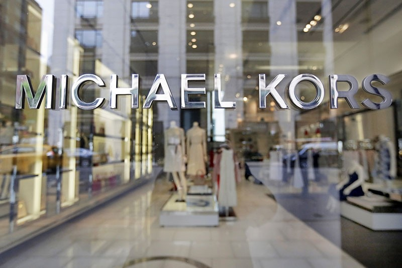 In this May 31, 2017, file photo the Michael Kors name adorns his store on Madison Avenue, in New York. (AP Photo)
