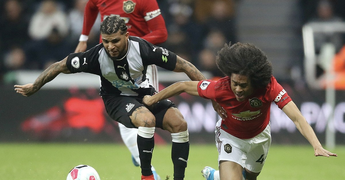 Newcastle United's DeAndre Yedlin (L) and Manchester United's Tahith Chong battle for the ball during  an English Premier League match at St James' Park, Newcastle, England, Oct. 6, 2019.