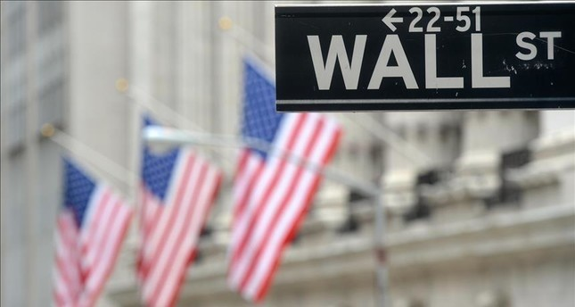 Wall Street closes higher with gains by banks